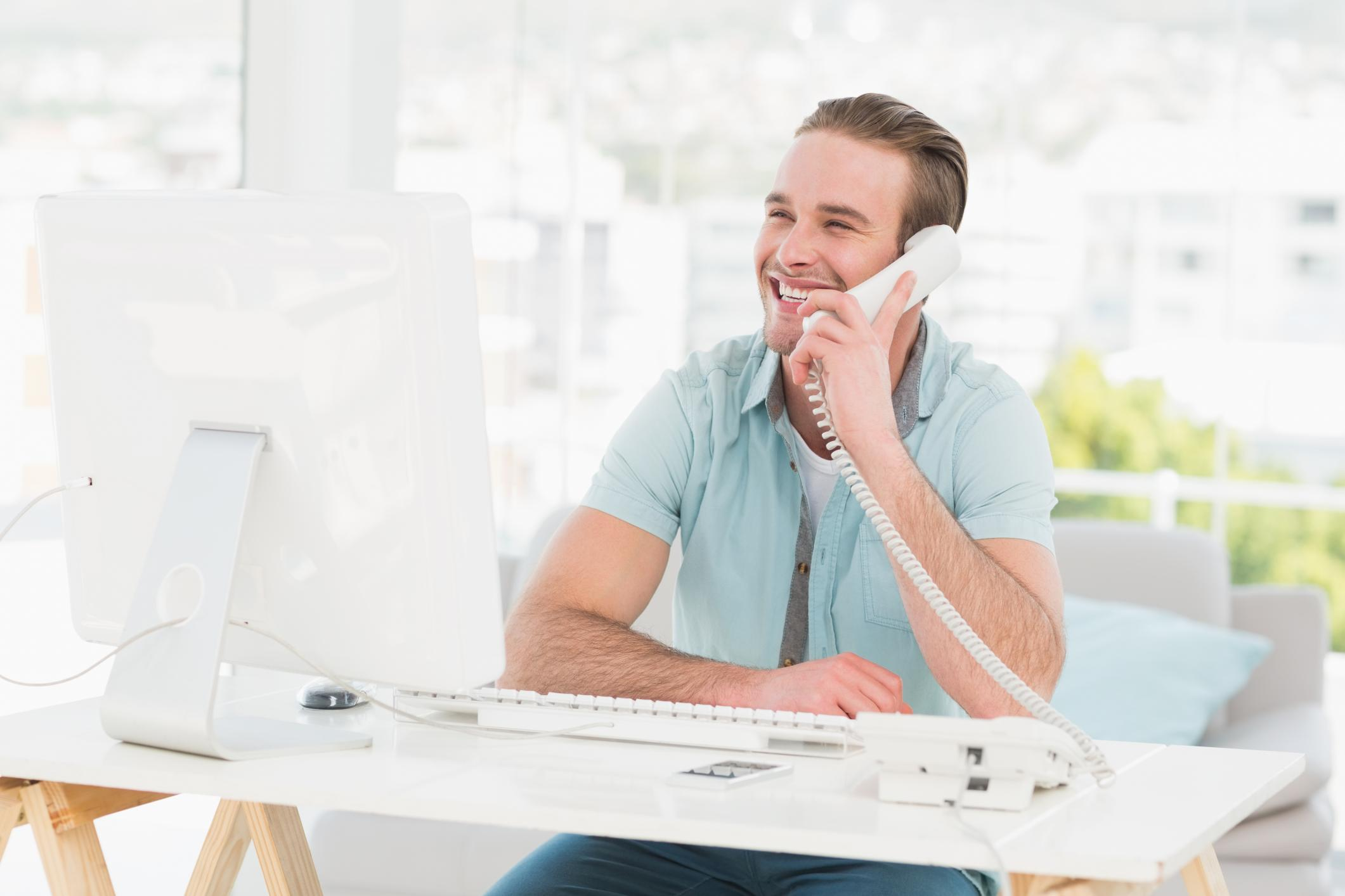 man calling on a telephone